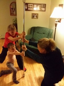 Geoff Kayber: Here is a picture of my wife, son, and nephew with the Festivus Pole... What did I marry into???