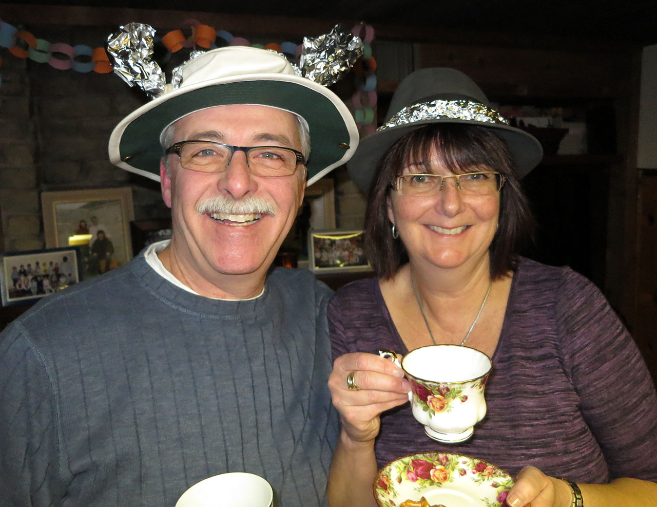 "Dave and Lynn abiding by the ""teacup"" rule. Note the hats and the tinfoil accoutrements."